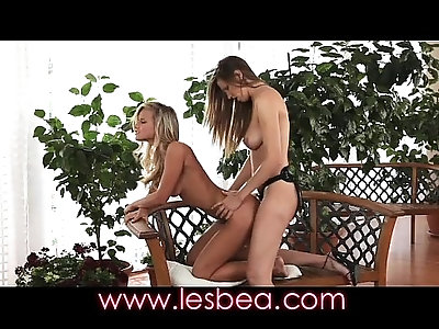Lesbea Blonde beauty sucks a wet clit before taking a strap on pounding
