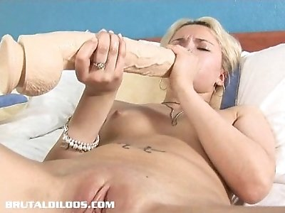 Blonde Russian fills her tight white pussy and ass with a big brutal dildo