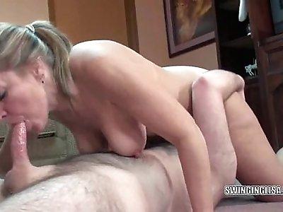 Curvy blonde sucking a cock