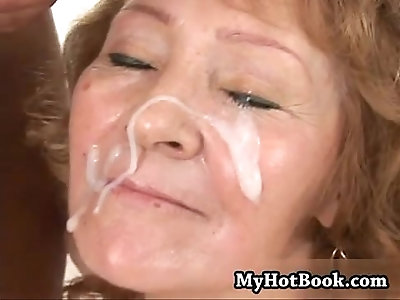 Enjoy watching a redheaded granny getting face