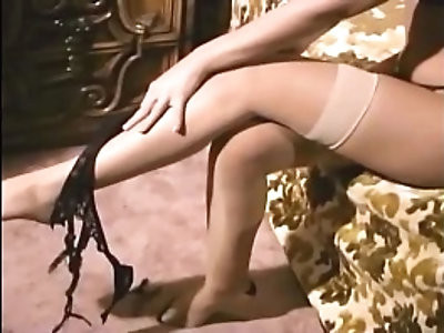 Glamour blonde in seamed stockings and stilettos