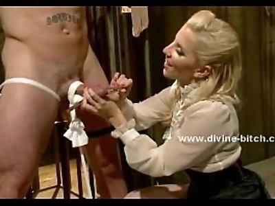 Gorgeous woman stumps on a submissiv man