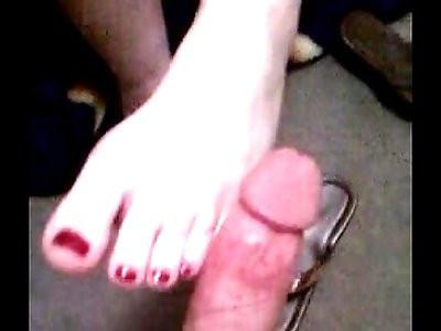 Raven Footjob Rubs Cock Between Her Toes
