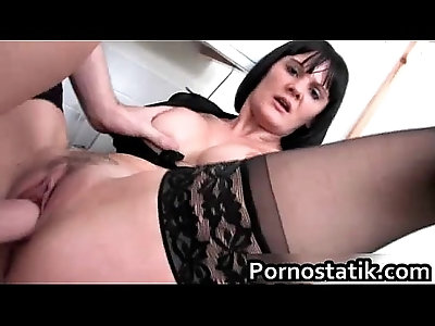 Black haired cougar in black stockings