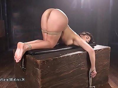 Bound brunette gets ass spanked