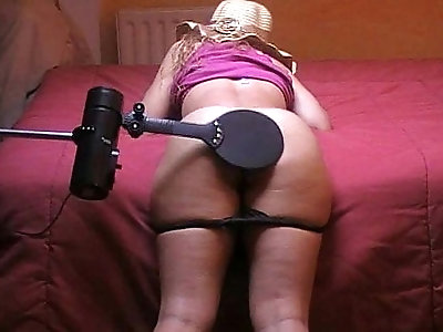 Spanker spanking machine a naughty girl plays with paddle and hairbrush