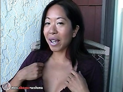 Asian Mame flashing huge boobs on a balcony in Canada