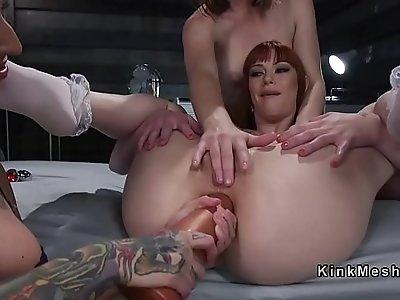 Lesbian slave gets deep hard anal penetration